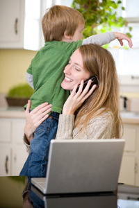 Woman with child and laptop