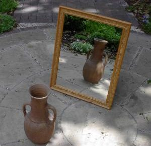 Jar in front of a mirror